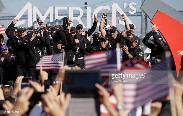 Oracle CEO Larry Ellison celebrates with the America's Cup trophy after Oracle Team USA beat Emirates Team New Zealand skippered by Dean Barker in...