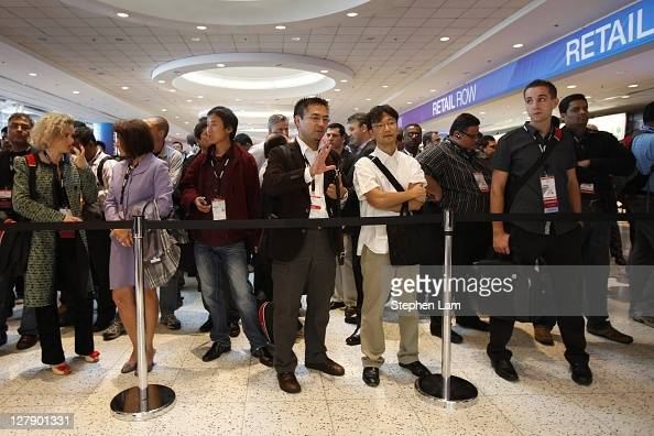 Oracle OpenWorld Conference attendees wait in line prior to the opening keynote address at the Moscone Center on October 2 2011 in San Francisco...
