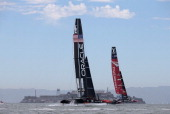 Oracle Team USA and Emirates Team New Zealand skippered by Dean Barker take practice before the start of race one of the Louis Vuitton Cup finals on...