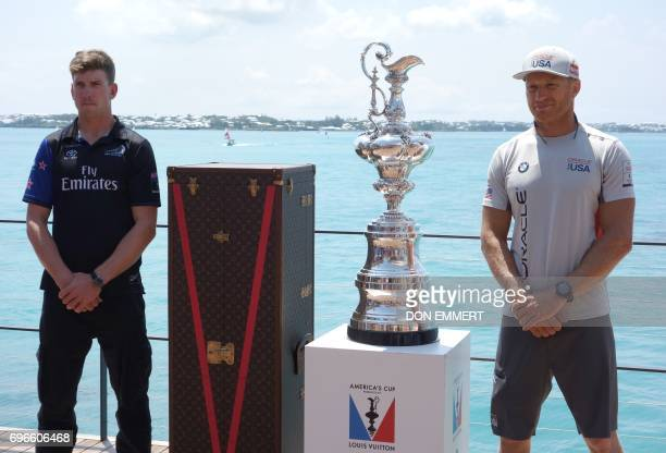 Oracle Team USA helmsman Jimmy Spithill and Emirates Team New Zealand helmsman Peter Burling pose for photos with the Auld Mug at Club AC June 16...