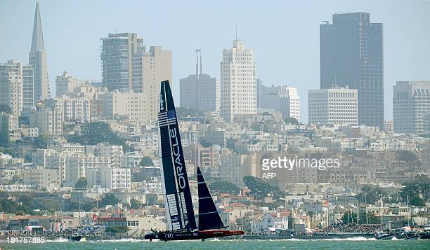 Oracle Team USA passes the San Francisco waterfront while sailing against Emirates Team New Zealand in America's Cup race 17 on September 24 in San...