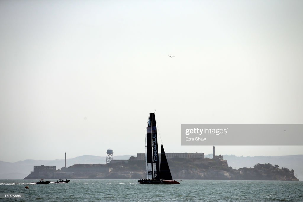 Oracle Team USA sails near Alcatraz Island during a training session on July 1, 2013 in San Francisco, California. Opening ceremony for the America's Cup is July 4, 2013. The finals begin on September 7, 2013 in San Francisco.