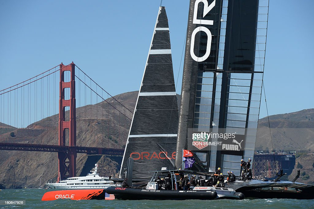 Oracle Team USA sails past the Golden Gate Bridge as it competes against Emirates Team New Zealand during the 34th America's Cup on September 15, 2013 in San Francisco. AFP PHOTO/Don Emmert