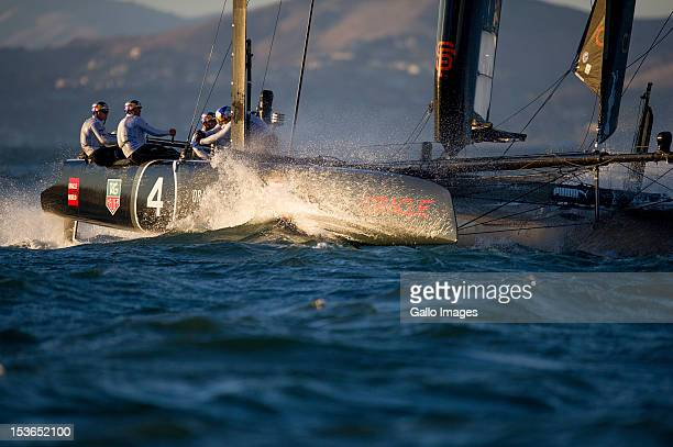 Oracle Team USA Skipper and Helmsman James Spithill reaches to the finish line during Day 4 of the America's Cup World Series on Occtober 6 2012 in...