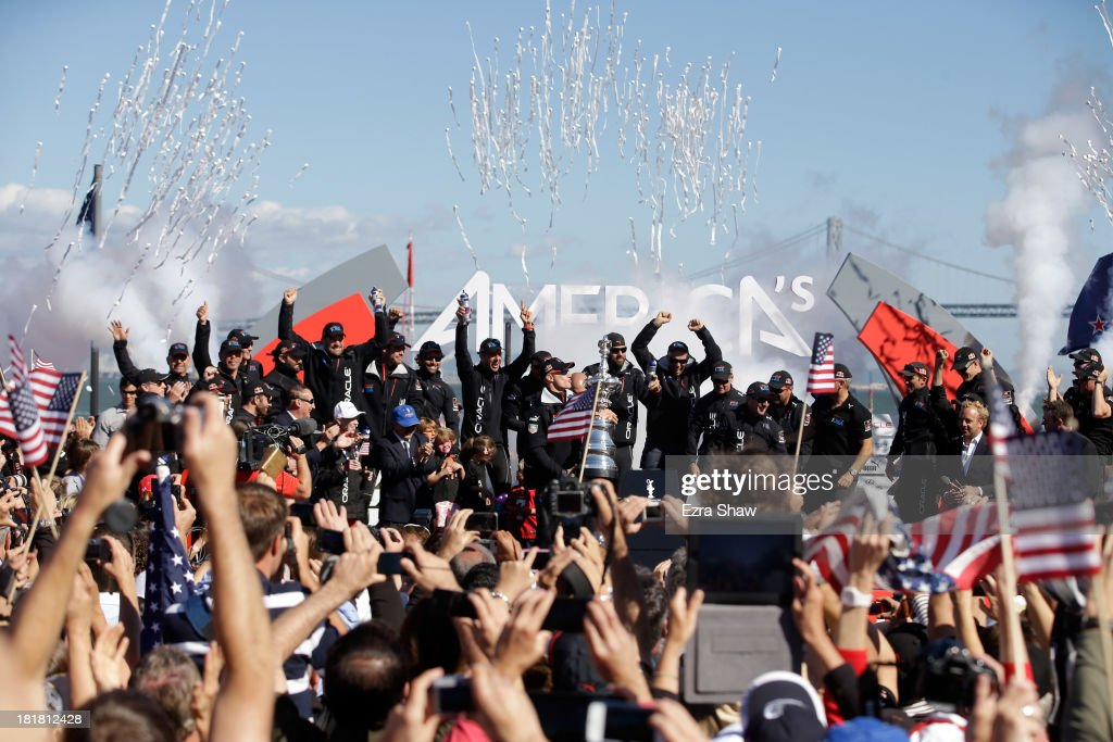 Oracle Team USA skipper James Spithill celebrates with the America's Cup trophy after they beat Emirates Team New Zealand skippered by Dean Barker in race 19 to win the America's Cup Finals on September 25, 2013 in San Francisco, California.
