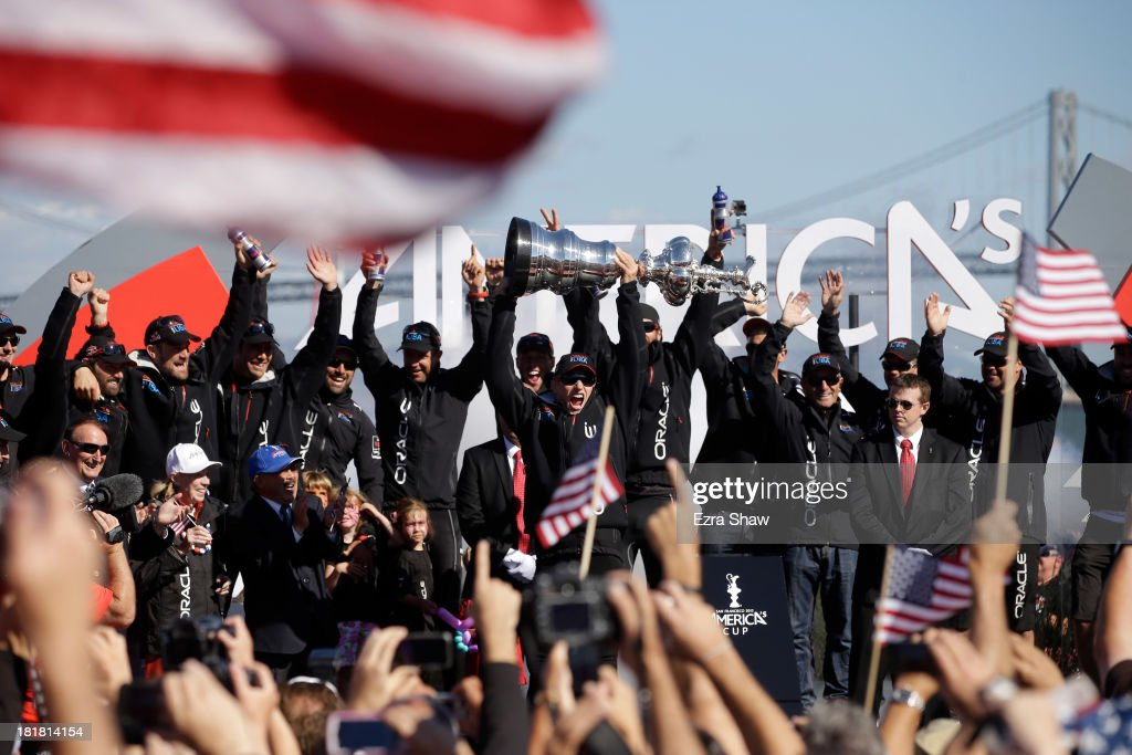 Oracle Team USA skipper James Spithill celebrates with the America's Cup trophy after they beat Emirates Team New Zealand skippered by Dean Barker in...