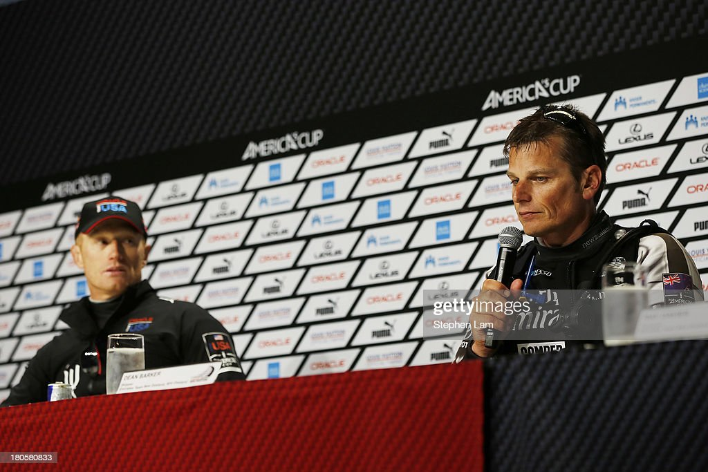 Oracle Team USA skipper James Spithill (L) watches as Emirates Team New Zealand skipper Dean Barker speaks to members of the media after race eight America's Cup finals on September 14, 2013 in San Francisco, California. Team Oracle won the race after Team New Zealand nearly capsized.