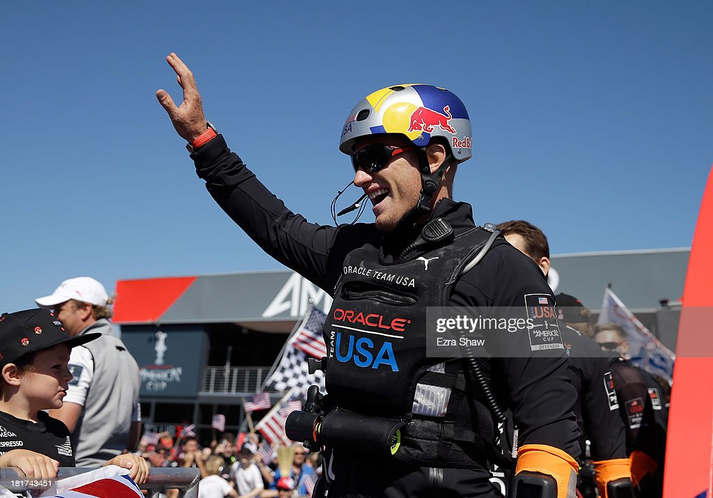 Oracle Team USA skipper James Spithill waves to the crowd after the dockout show before going out to race against Emirates Team New Zealand in race...