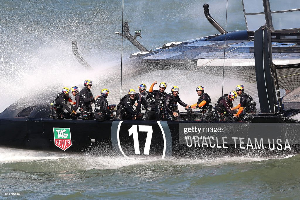 Oracle Team USA skippered by James Spithill celebrates after finishing ahead of Emirates Team New Zealand skippered by Dean Barker during race 18 of the America's Cup Finals on September 24, 2013 in San Francisco, California. Team USA swept two races today against Team New Zealand to tie the series at 8, settiing up a winner-take-all race tomorrow.