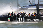 Oracle Team USA skippered by James Spithill celebrates after finishing ahead of Emirates Team New Zealand skippered by Dean Barker during race 18 of...