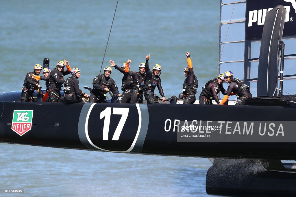 Oracle Team USA skippered by James Spithill celebrates after crossing the finish line ahead of Emirates Team New Zealand skippered by Dean Barker during race 17 of the America's Cup Finals on September 24, 2013 in San Francisco, California.
