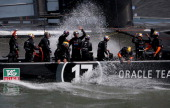 Oracle Team USA skippered by James Spithill celebrates after defending the cup as they beat Emirates Team New Zealand to defend the America's Cup...
