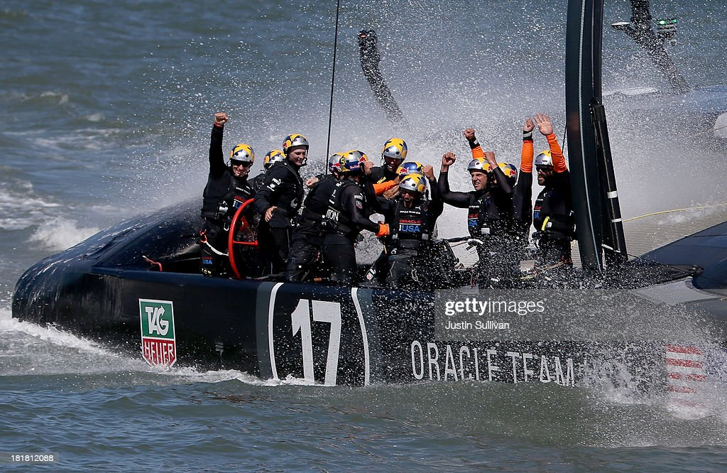 Oracle Team USA skippered by James Spithill celebrates after defending the cup as they beat Emirates Team New Zealand to defend the America's Cup during the final race on September 25, 2013 in San Francisco, California.