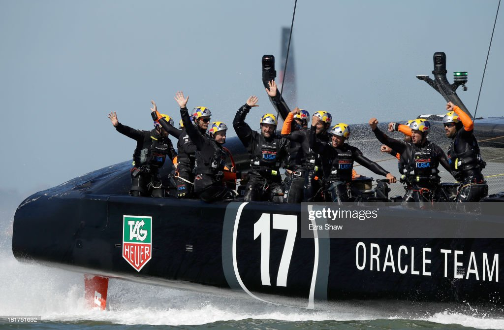 Oracle Team USA skippered by James Spithill celebrates after they crossed the finish line to beat Emirates Team New Zealand in race 18 of the...