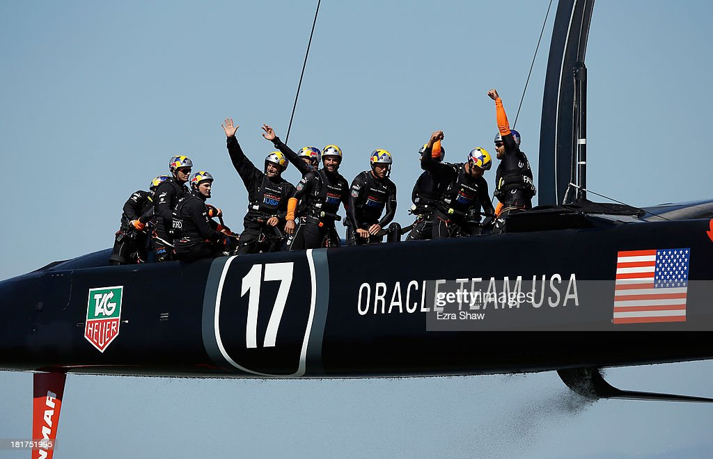 Oracle Team USA skippered by James Spithill celebrates after they crossed the finish line to beat Emirates Team New Zealand in race 17 of the America's Cup Finals on September 24, 2013 in San Francisco, California.