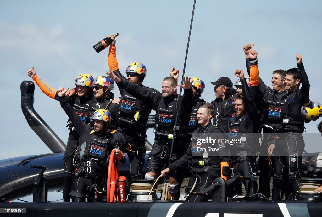 Oracle Team USA skippered by James Spithill celebrates after they beat Emirates Team New Zealand skippered by Dean Barker in race 19 to win the America's Cup Finals on September 25, 2013 in San Francisco, California.