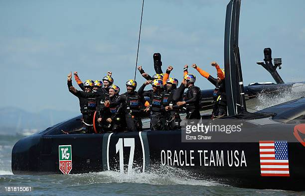 Oracle Team USA skippered by James Spithill celebrates after they beat Emirates Team New Zealand skippered by Dean Barker in race 19 to win the...