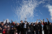 Oracle Team USA skippered by James Spithill celebrates onstage after defending the Cup as they beat Emirates Team New Zealand to defend the America's...