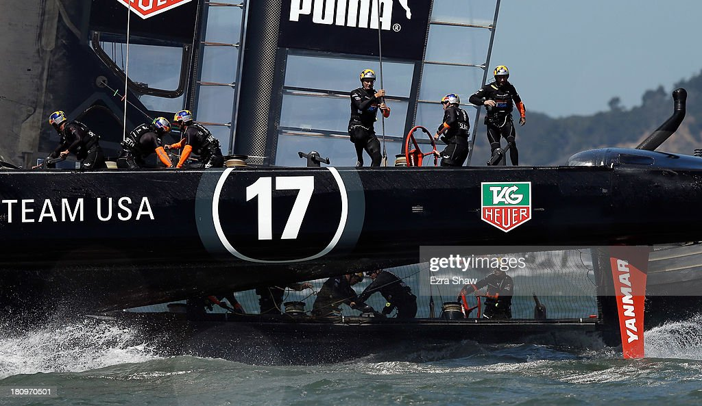 Oracle Team USA skippered by James Spithill in action against Emirates Team New Zealand skippered by Dean Barker in action against during race 11 of the America's Cup Finals on September 18, 2013 in San Francisco, California. Emirates Team New Zealand won the race.
