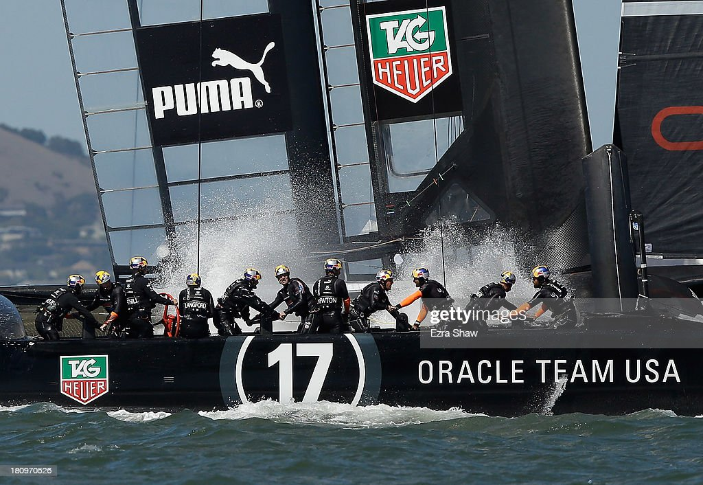 Oracle Team USA skippered by James Spithill in action against Emirates Team New Zealand skippered by Dean Barker during race 12 of the America's Cup Finals on September 18, 2013 in San Francisco, California. The race was postponed right before the race began but both teams still raced to the first mark.