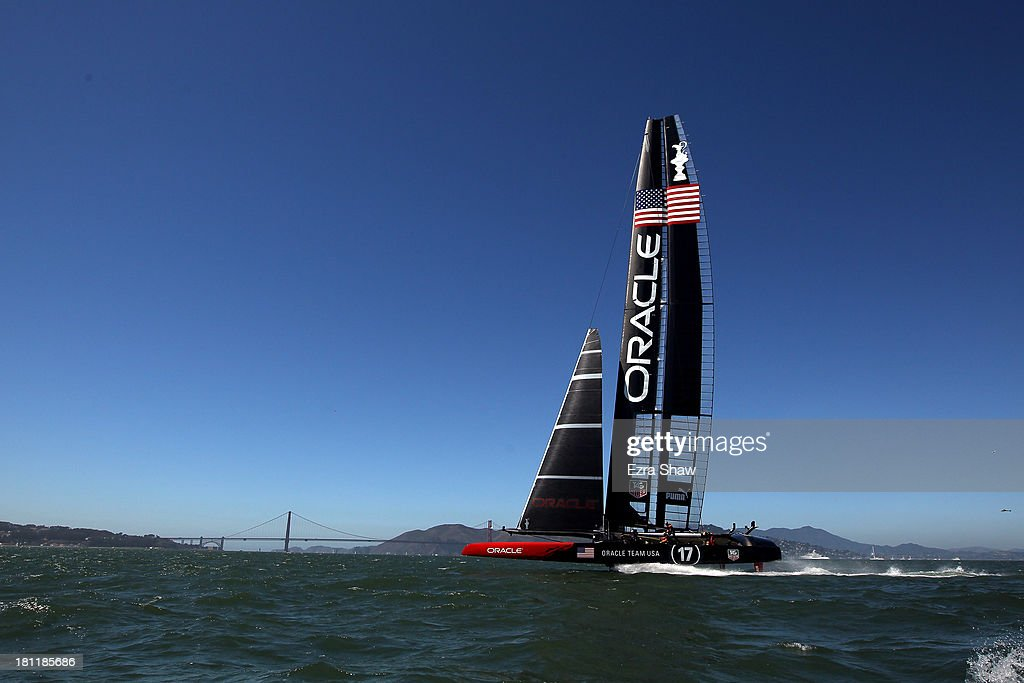Oracle Team USA skippered by James Spithill in action against Emirates Team New Zealand skippered by Dean Barker during race 12 of the America's Cup Finals on September 19, 2013 in San Francisco, California.