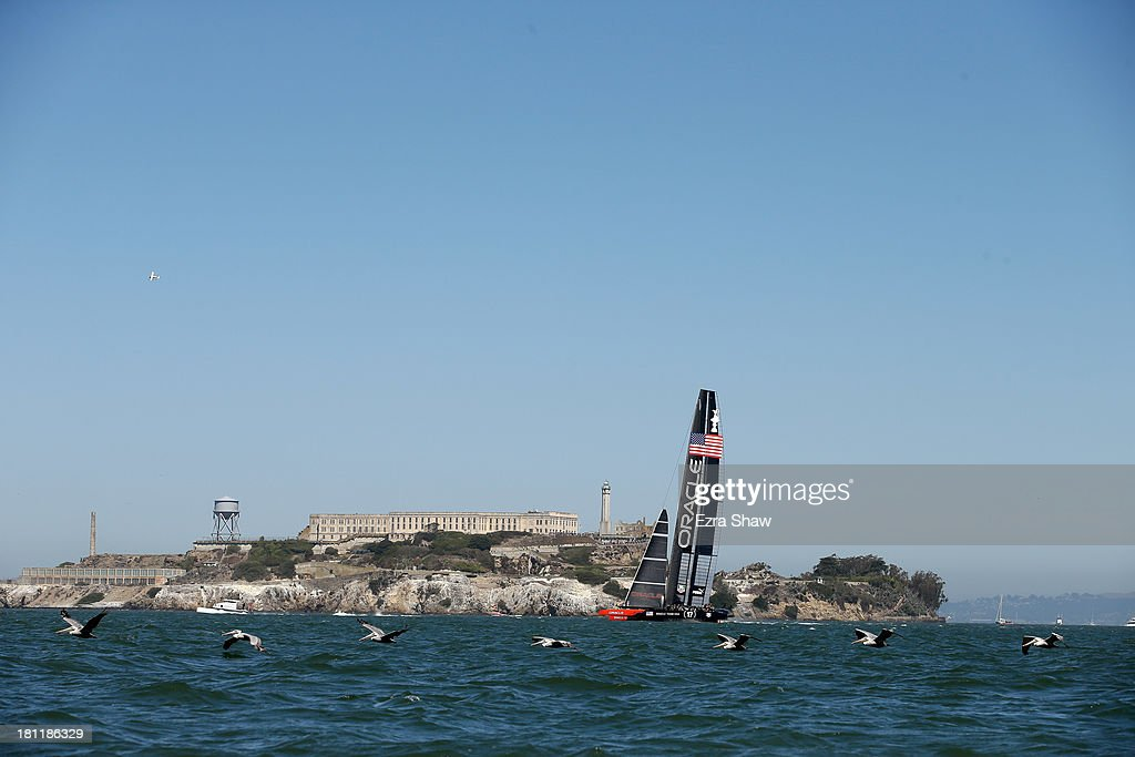 Oracle Team USA skippered by James Spithill in action against Emirates Team New Zealand during race 12 of the America's Cup Finals on September 19, 2013 in San Francisco, California. Oracle Team USA won race 12 and race 13 was postponed due to high winds.