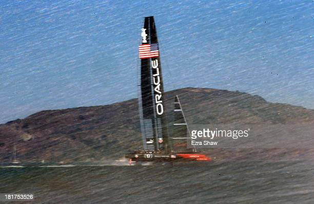 Oracle Team USA skippered by James Spithill in action against Emirates Team New Zealand skippered by Dean Barker during race 17 of the America's Cup...