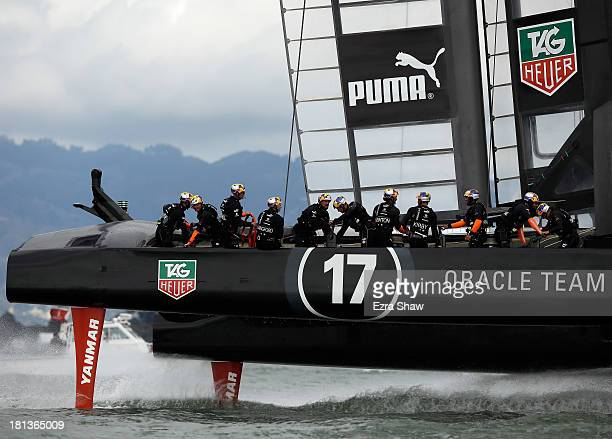 Oracle Team USA skippered by James Spithill races against Emirates Team New Zealand skippered by Dean Barker during race 13 of the America's Cup...
