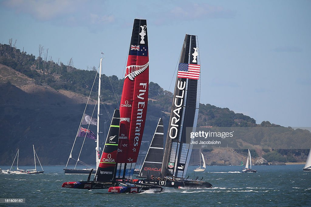 Oracle Team USA skippered by James Spithill races against Emirates Team New Zealand skippered by Dean Barker during the final race of the America's Cup Finals on September 25, 2013 in San Francisco, California.
