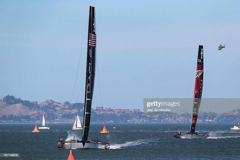 Oracle Team USA skippered by James Spithill sails ahead of Emirates Team New Zealand skippered by Dean Barker during race 17 of the America's Cup Finals on September 24, 2013 in San Francisco, California.