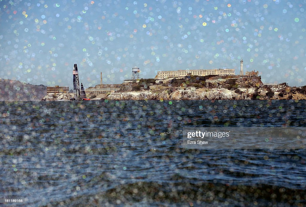 Oracle Team USA skippered by James Spithill sails past Alcatraz Island during race 12 against Emirates Team New Zealand in the America's Cup Finals on September 19, 2013 in San Francisco, California. Oracle Team USA won race 12 and race 13 was postponed due to high winds.