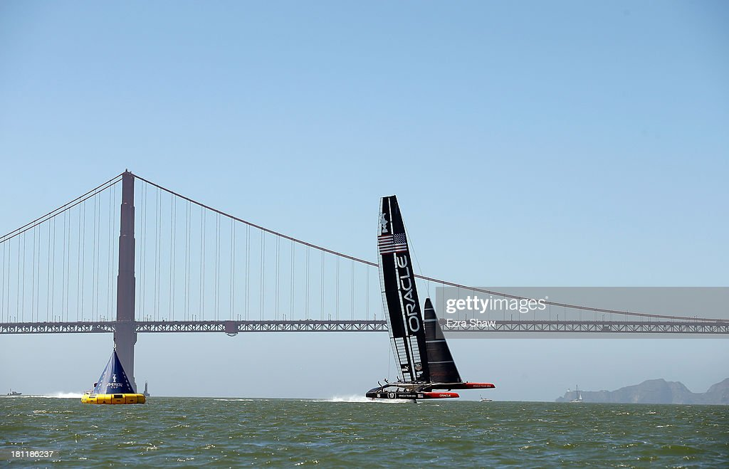 Oracle Team USA skippered by James Spithill warms up near the Golden Gate Bridge before race 12 against Emirates Team New Zealand in the America's Cup Finals on September 19, 2013 in San Francisco, California. Oracle Team USA won race 12 and race 13 was postponed due to high winds.