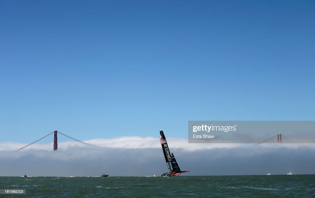 Oracle Team USA skippered by James Spithill warms up near the Golden Gate Bridge before racing against Emirates Team New Zealand in race 14 of the America's Cup Finals on September 22, 2013 in San Francisco, California. Oracle Team USA won both race 14 and 15 today.