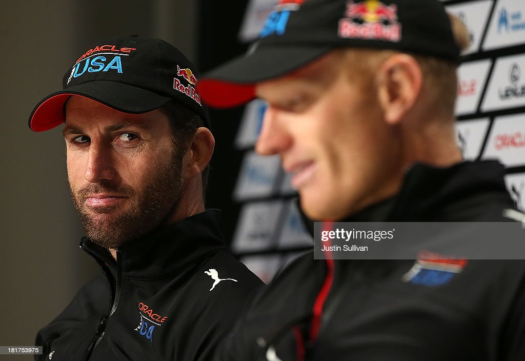 Oracle Team USA tactician Sir Ben Ainslie (L) looks on as skipper James Spithill (R) speaks during a news conference following races 17 and 18 of the America's Cup finals against Oracle Team USA on September 24, 2013 in San Francisco, California. Team USA swept the two races today against Team New Zealand to tie the series at 8, settiing up a winner-take-all race tomorrow.
