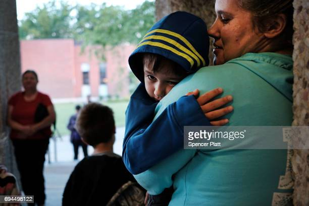 Oran McCall waits with his mother to register at dawn after sleeping in their cars to see a doctor at the Remote Area Medical mobile dental and...