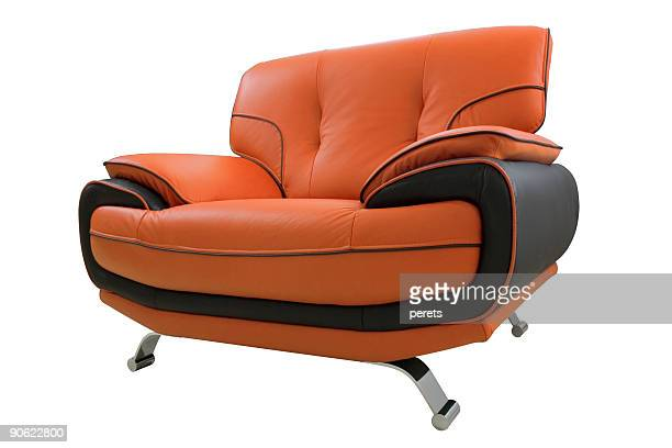 Orange and black leather armchair isolated on white