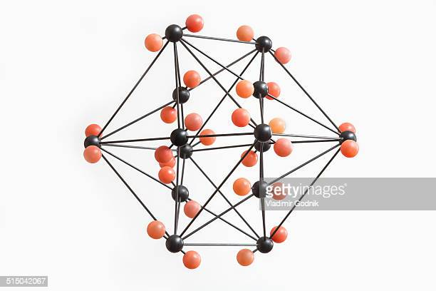 Orange and black molecular structure against white background