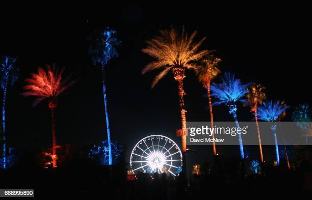 Orange and blue palm trees and the ferris wheel are seen during day 2 of the Coachella Valley Music And Arts Festival at the Empire Polo Club on...