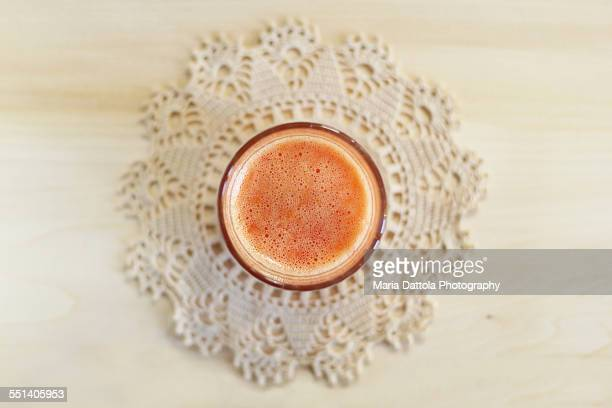 Orange and carrot juice bubbles, overhead view