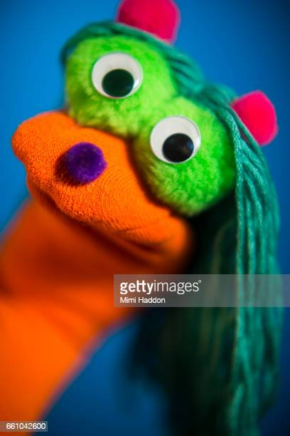 Orange and Green Sock Puppet on Blue Seamless