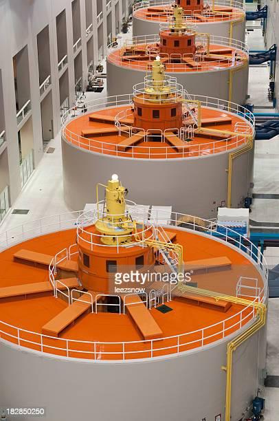 Orange and white round hydro-electric power generators