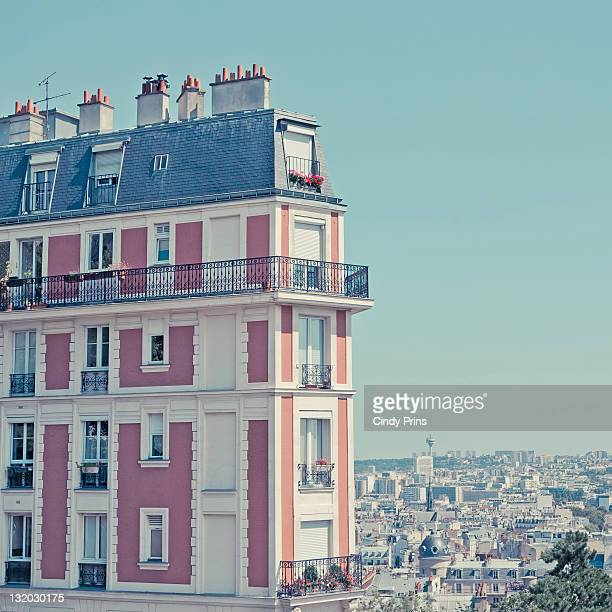 Orange apartment building with view over Paris