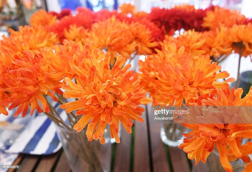 Orange Artificial Gerbera Flowers in Glass Vase : Foto de stock