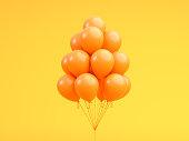 "Orange balloons floating in Orange ""n pastel background room studio. minimal idea creative concept. 3d render"
