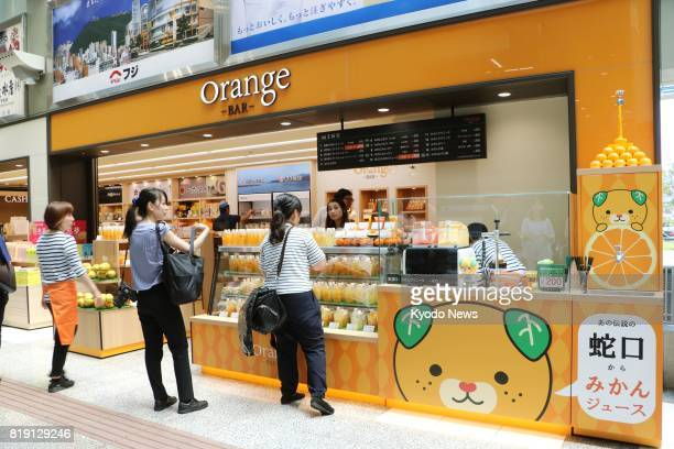 Orange Bar a new stand selling juice and desserts using local citrus fruits opens at Matsuyama airport in the western Japan prefecture of Ehime on...
