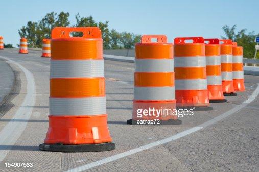Orange barrels used in highway maintenance construction