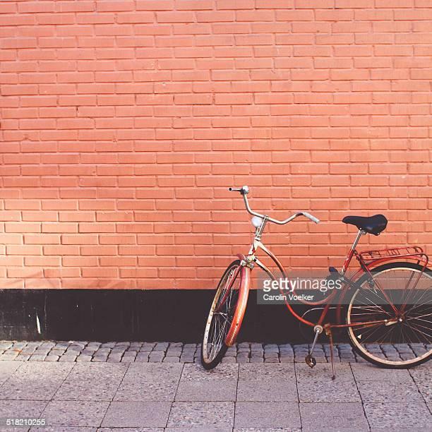 Orange bike in front of an orange wall