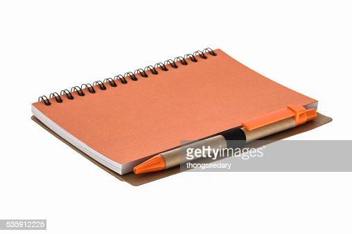 orange book y lápiz : Foto de stock