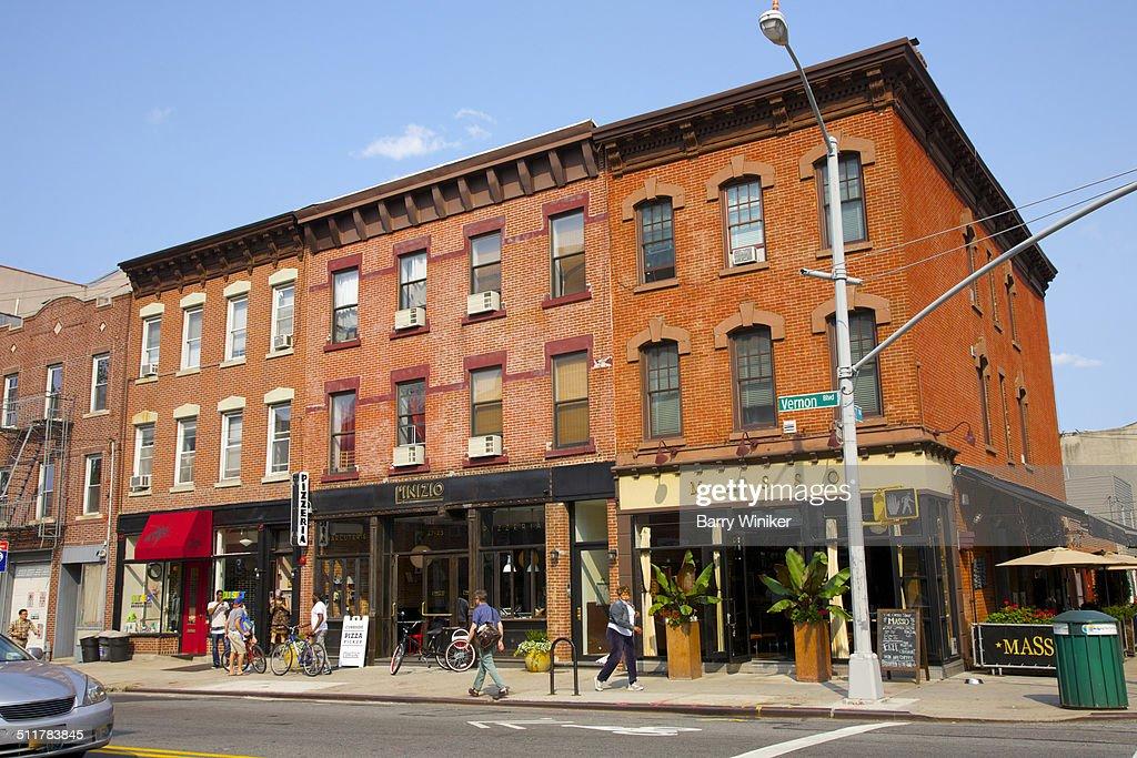 Orange brick buildings and retail below apartments