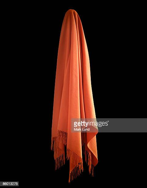 Orange Cashmere Blanket Hanging in Black Space